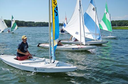 COURTESY ROBERT HARRRIS Sunfish racing by members of the Menantic Yacht Club.
